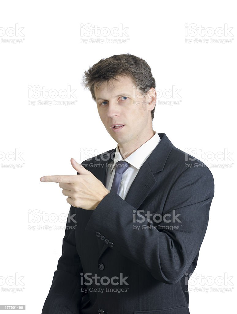 Guy in Suit Points to Left stock photo