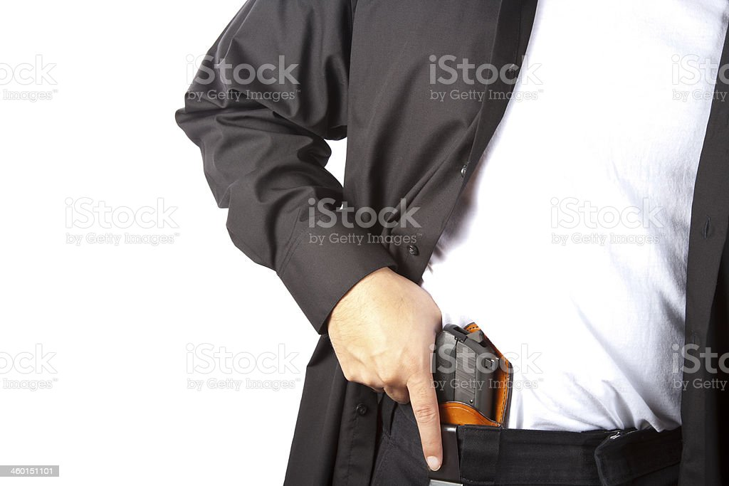 Guy in suit with concealed carry stock photo