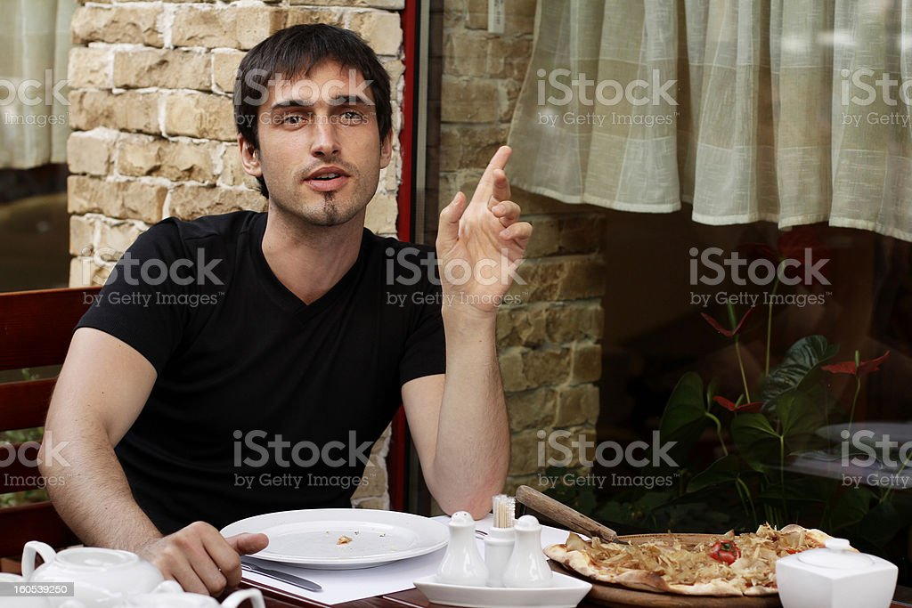 Guy is asking a bill for pizza royalty-free stock photo