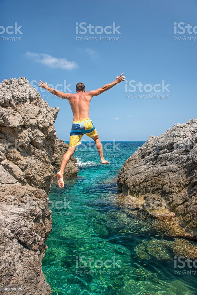 Guy jumping off a Cliff on Vacation, Mallorca stock photo