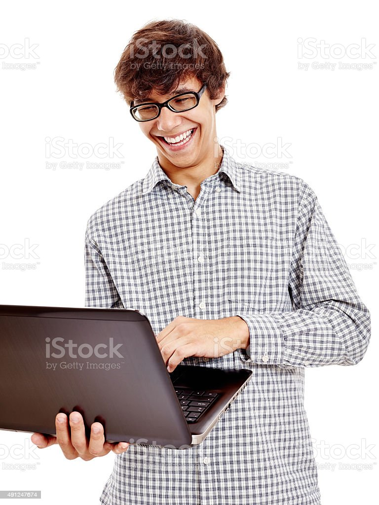 Guy laughing with laptop stock photo