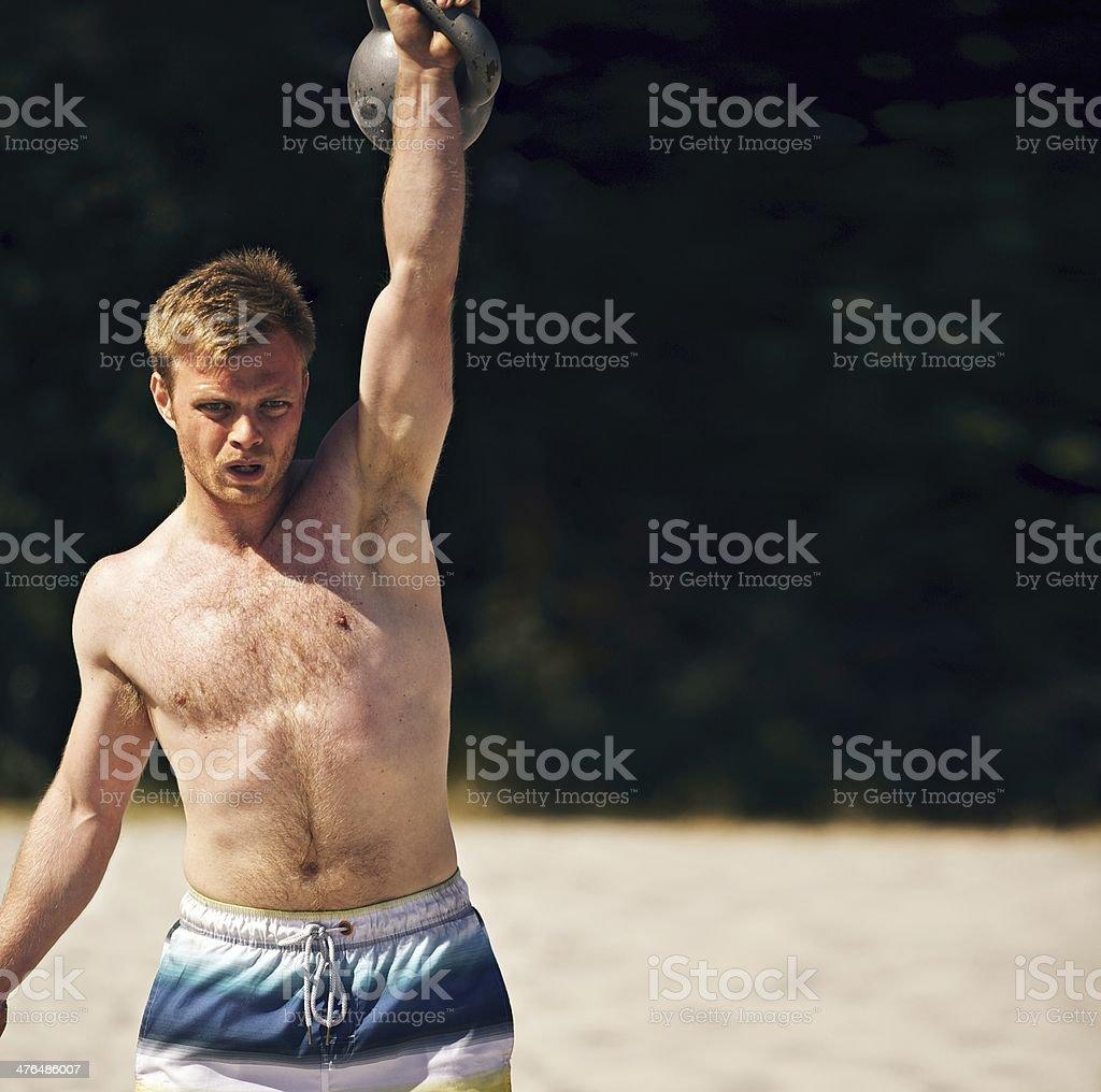 Guy Lifting Heavy Kettlebell royalty-free stock photo