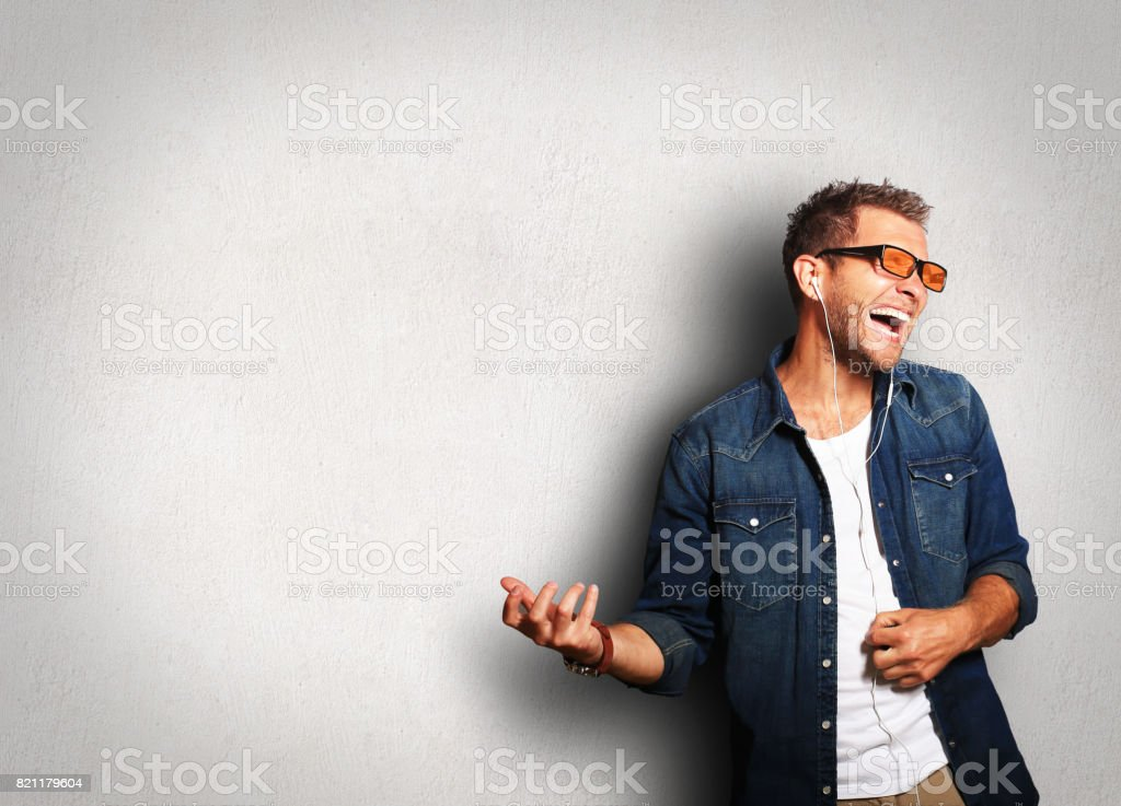 Guy listening to music stock photo