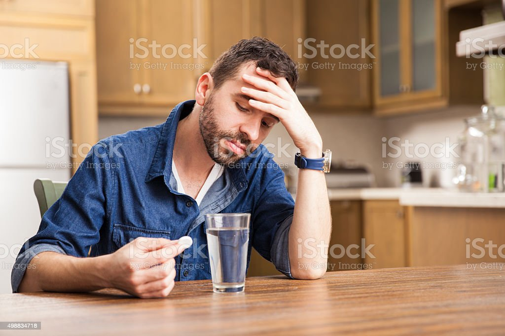 Guy not feeling great today stock photo