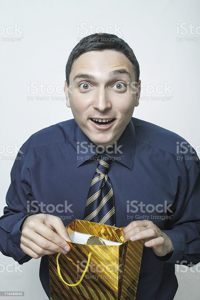 guy opening pouch with gift royalty-free stock photo