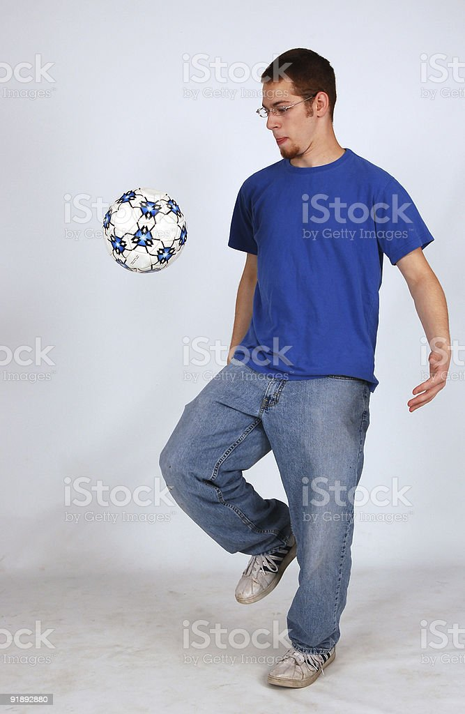 guy playing soccer stock photo
