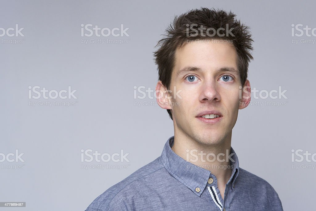 Guy posing against gray background stock photo