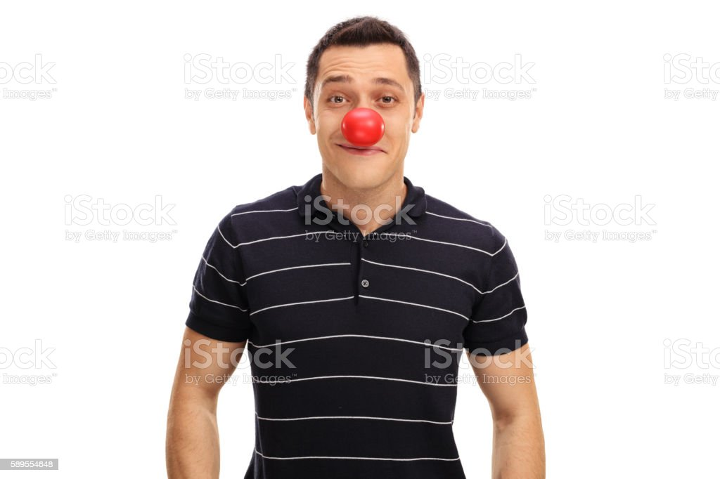 Guy posing with a red clown nose stock photo