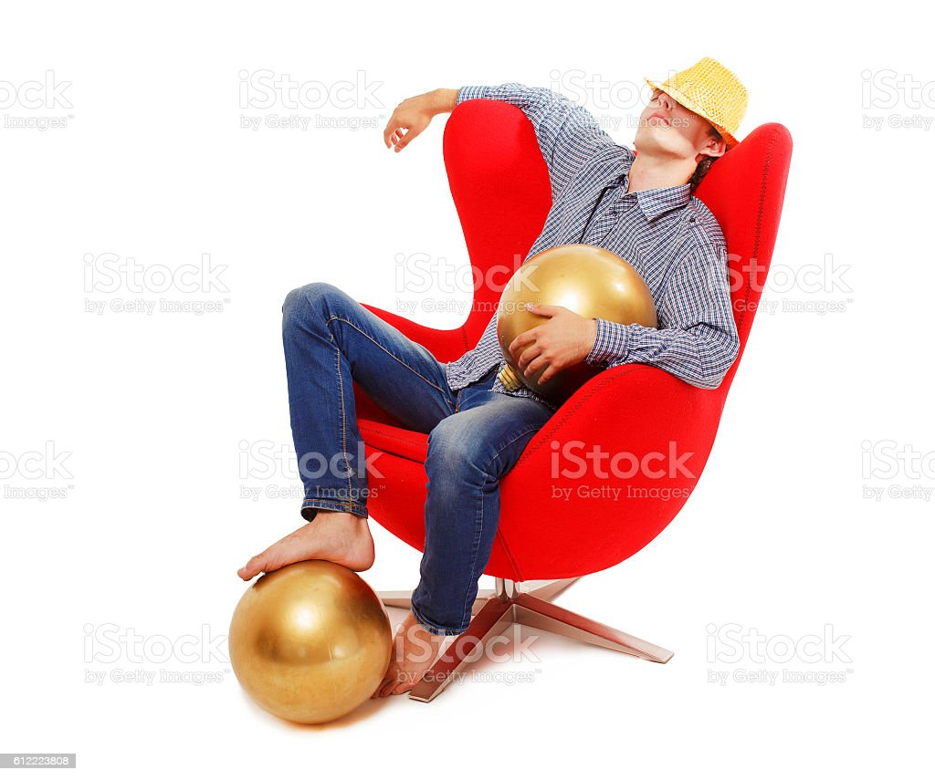 guy resting in a chair after the New Year's party stock photo