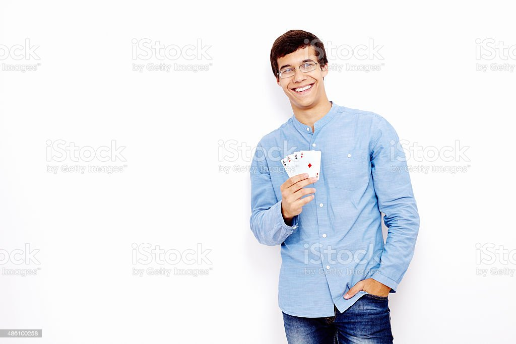 Guy showing playing cards stock photo