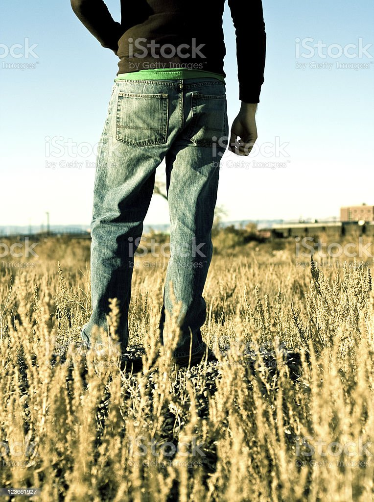 Guy Standing in Field stock photo