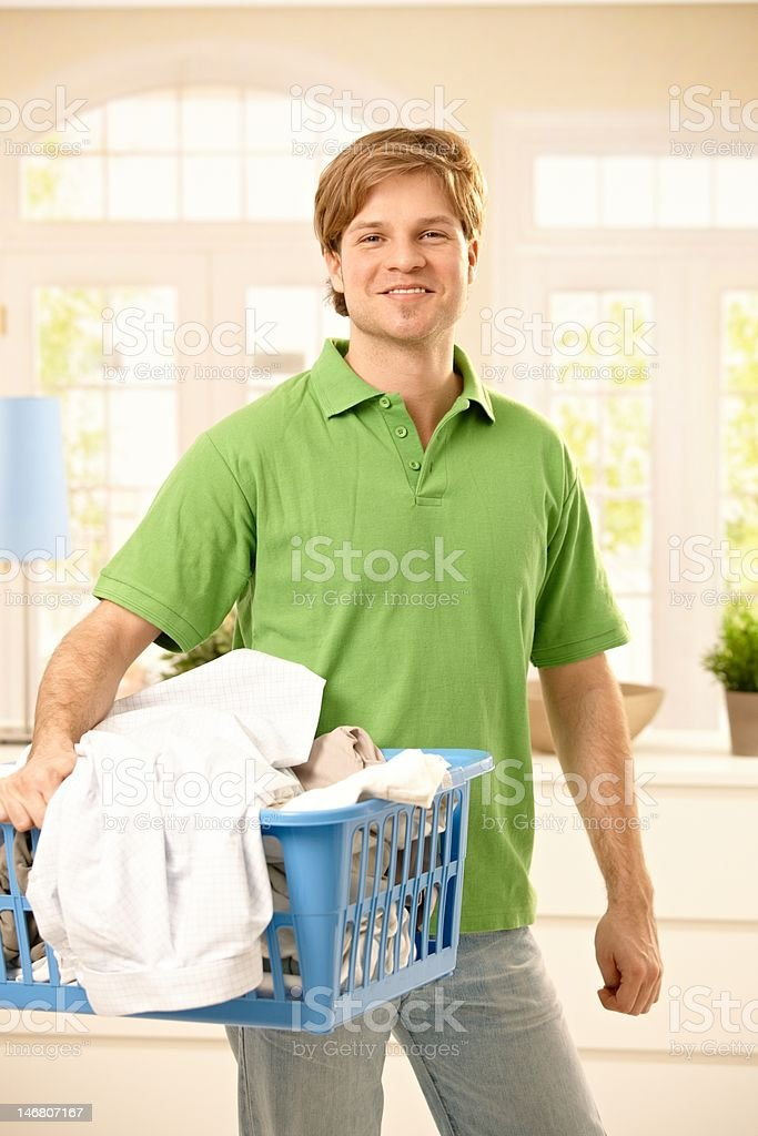 Guy taking clothes to wash royalty-free stock photo