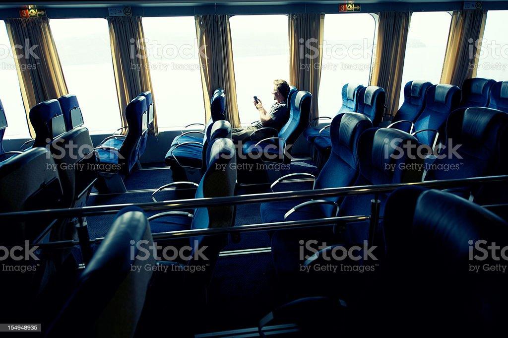 Guy Texts From Empty Passenger Seats royalty-free stock photo