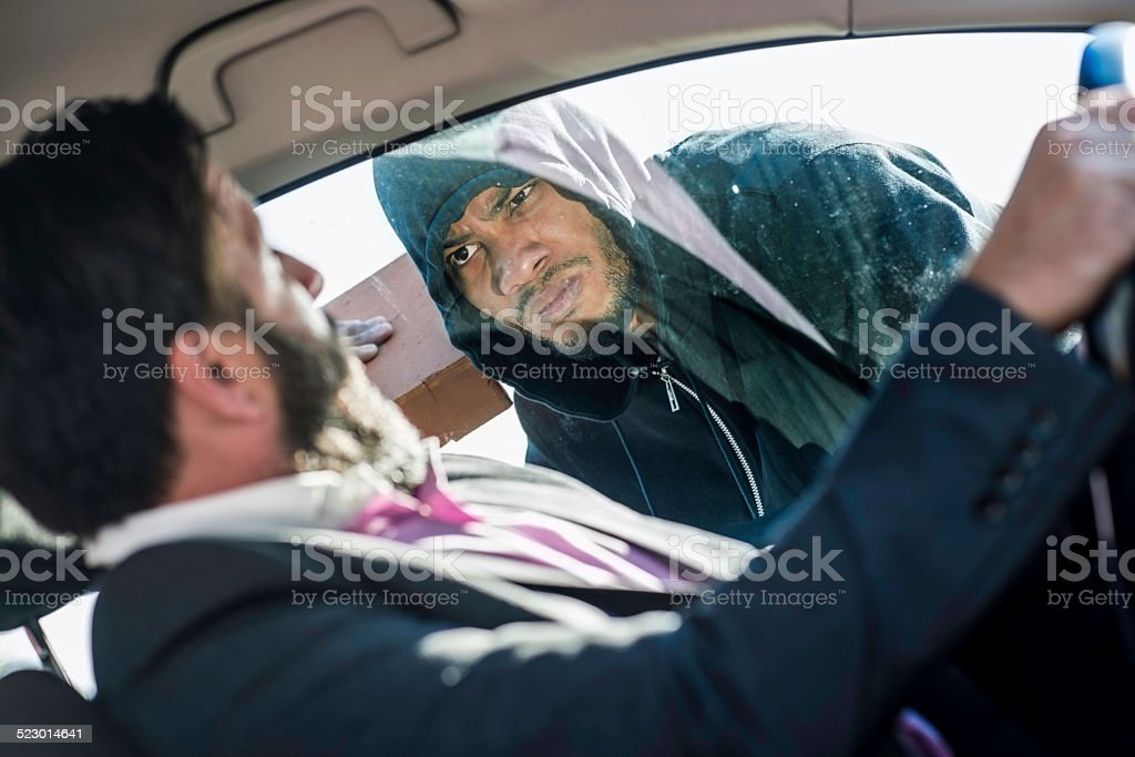 Guy Trying To Steal A Driver stock photo