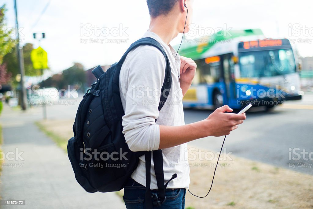 Guy Waiting for the Bus stock photo
