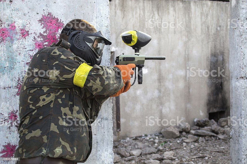 Guy with a paintball gun stock photo