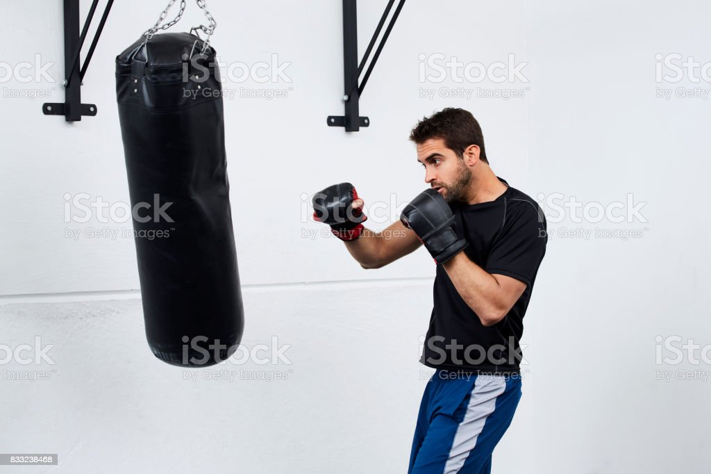 Guy with a punch bag stock photo