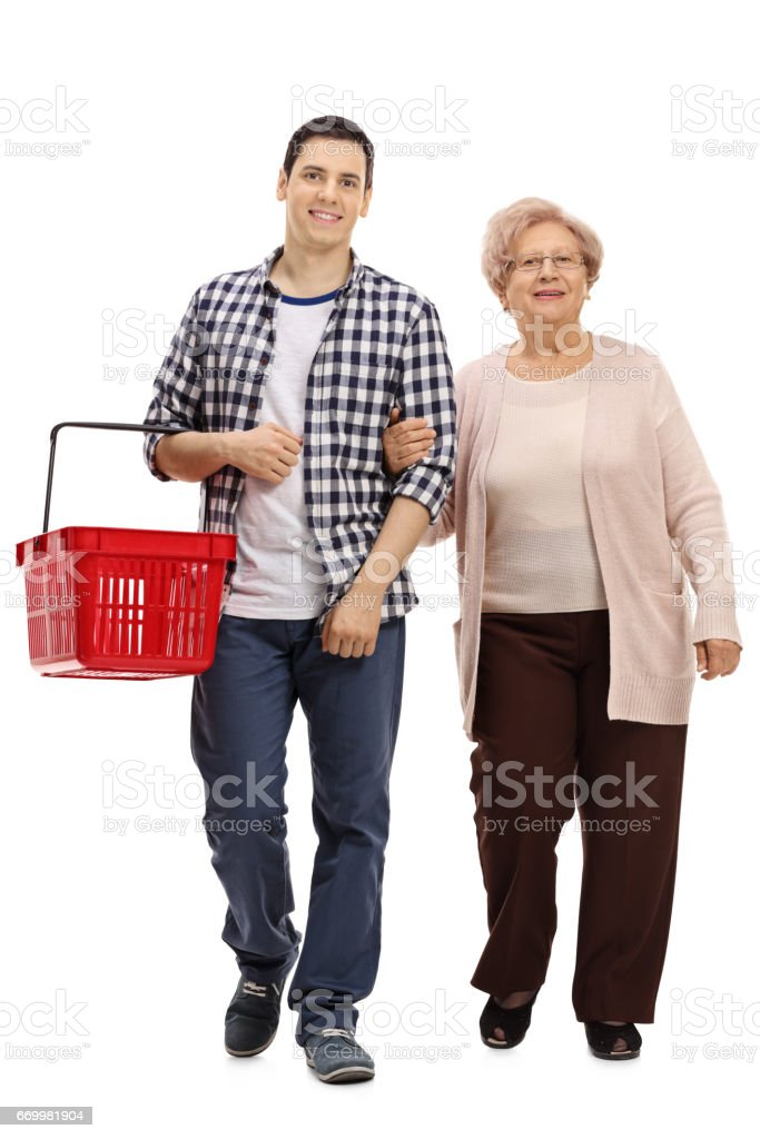 Guy with a shopping basket and a mature woman walking stock photo