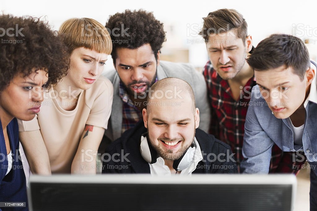 IT Guy With Astonished Colleagues royalty-free stock photo