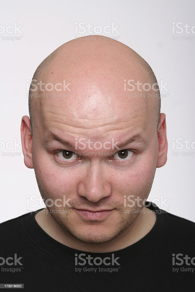 Guy with bald head and raised eyebrows royalty-free stock photo