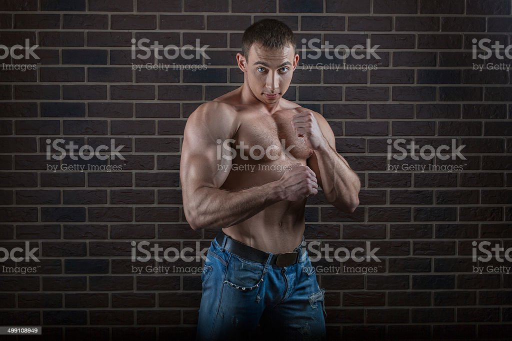 Guy with big myshchami. royalty-free stock photo