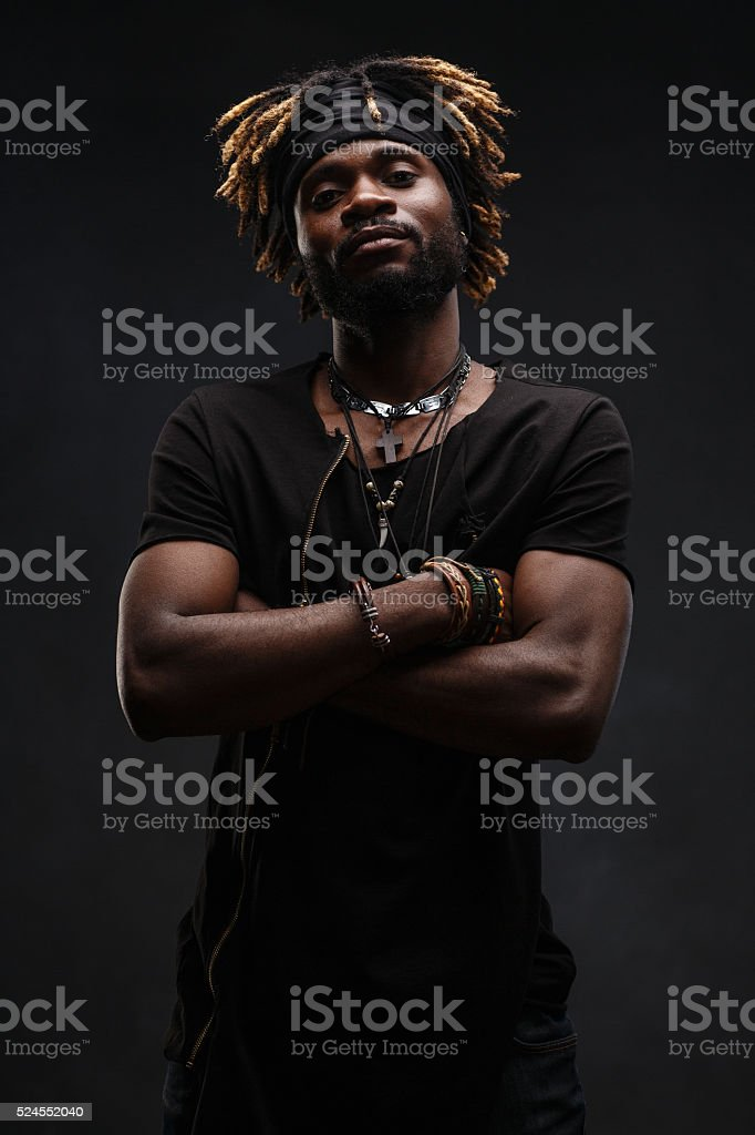 Guy with dreadlocks stock photo