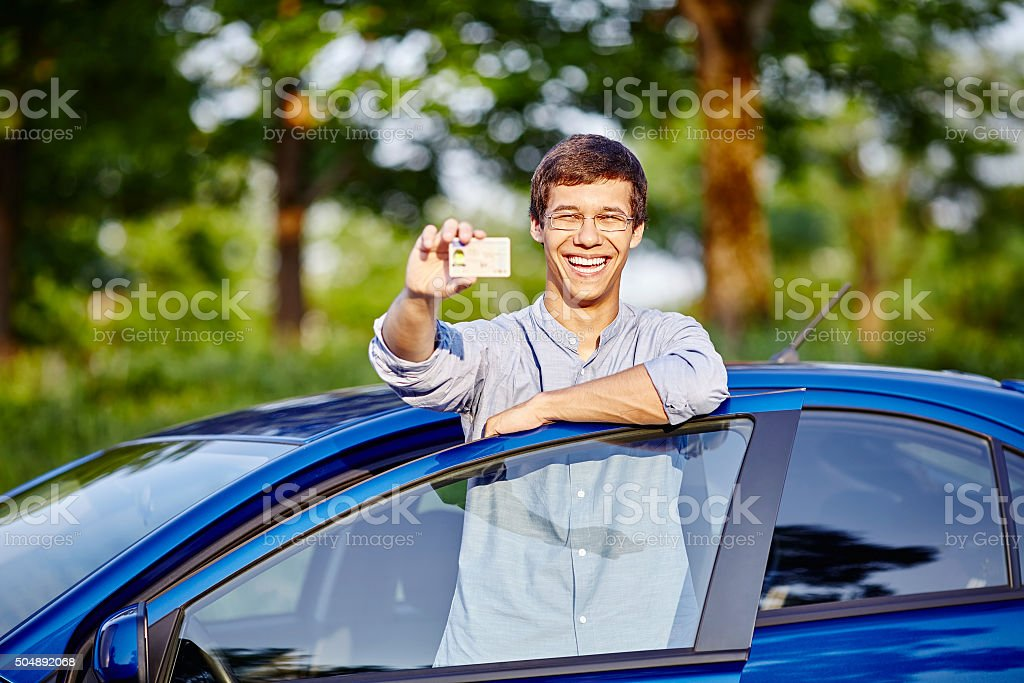 Guy with driving license stock photo