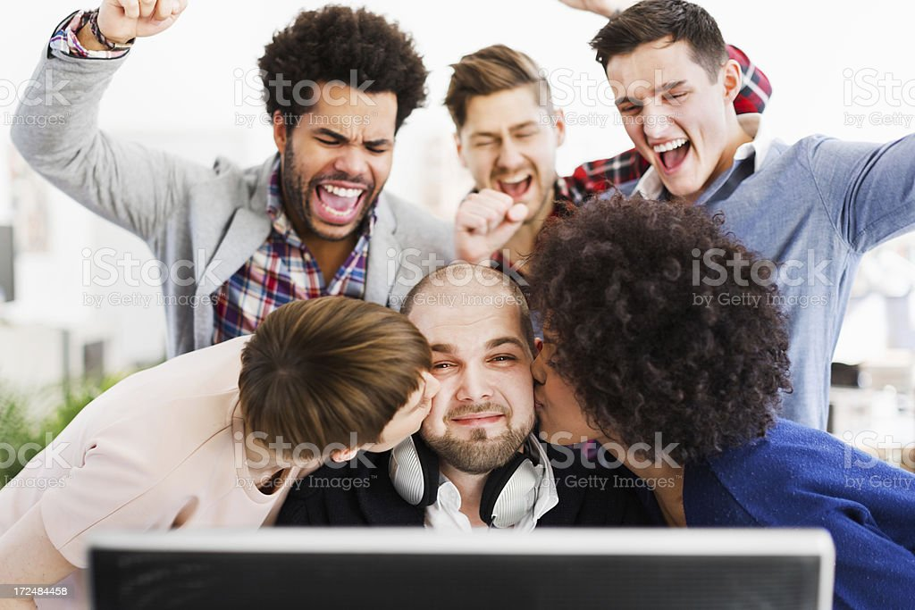 IT Guy With Excited Colleagues royalty-free stock photo