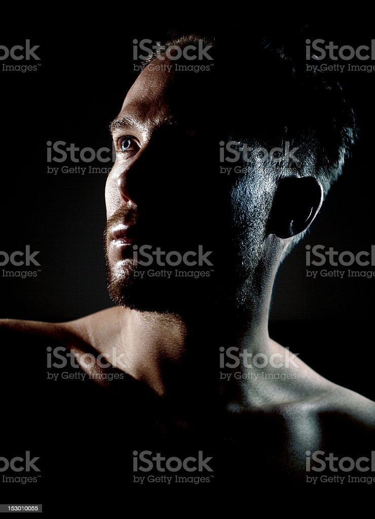 Guy with focused eye royalty-free stock photo