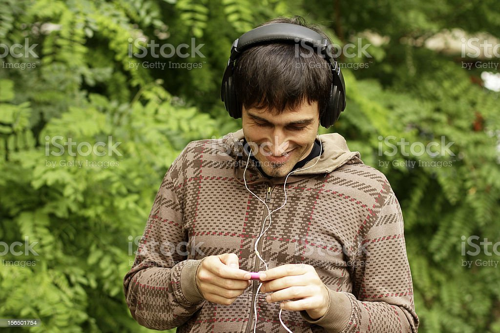 Guy with headphones is listening to music royalty-free stock photo