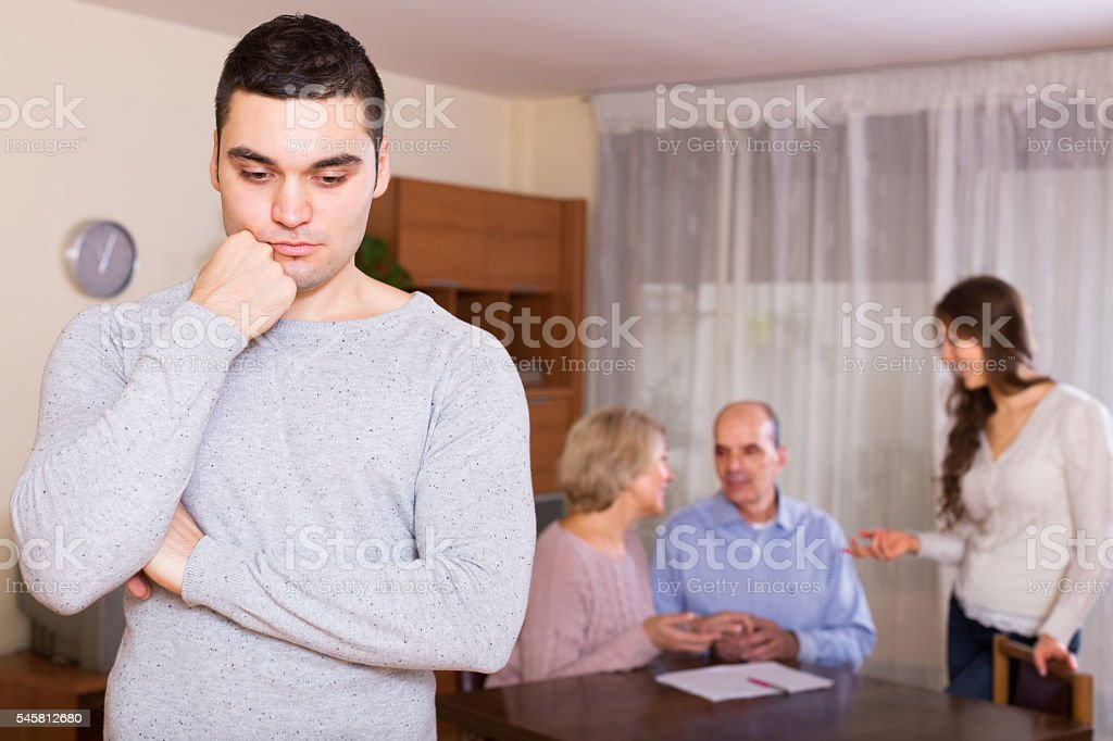 guy with injured look after quarrel stock photo