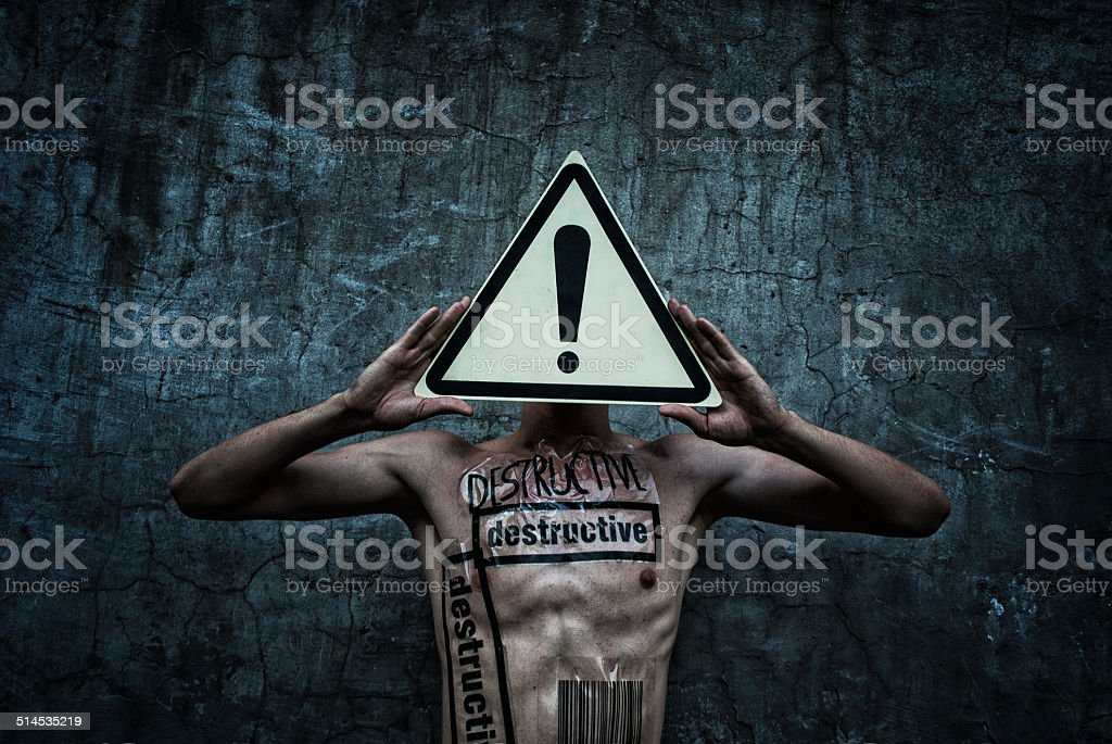guy with stickers and the road sign in hand royalty-free stock photo