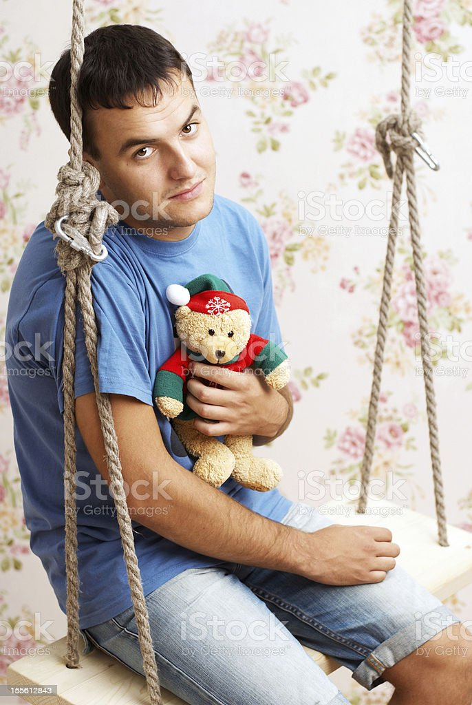 guy with teddy bear in his hands royalty-free stock photo