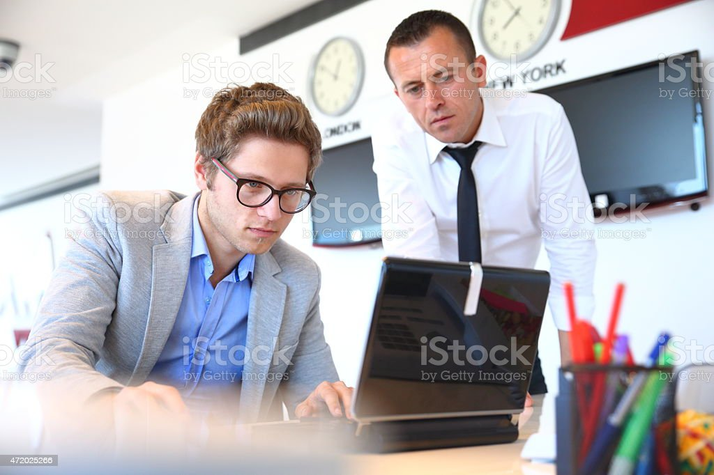 IT Guy Working At Desk stock photo