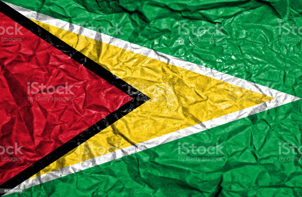 Guyana vintage flag on old crumpled paper background stock photo