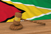 Guyanese Law Concept - Flag of Guyana Behind Judge's Gavel