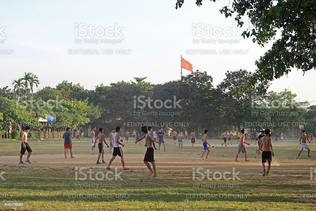guys are playing football outdoor in Hue, Vietnam stock photo