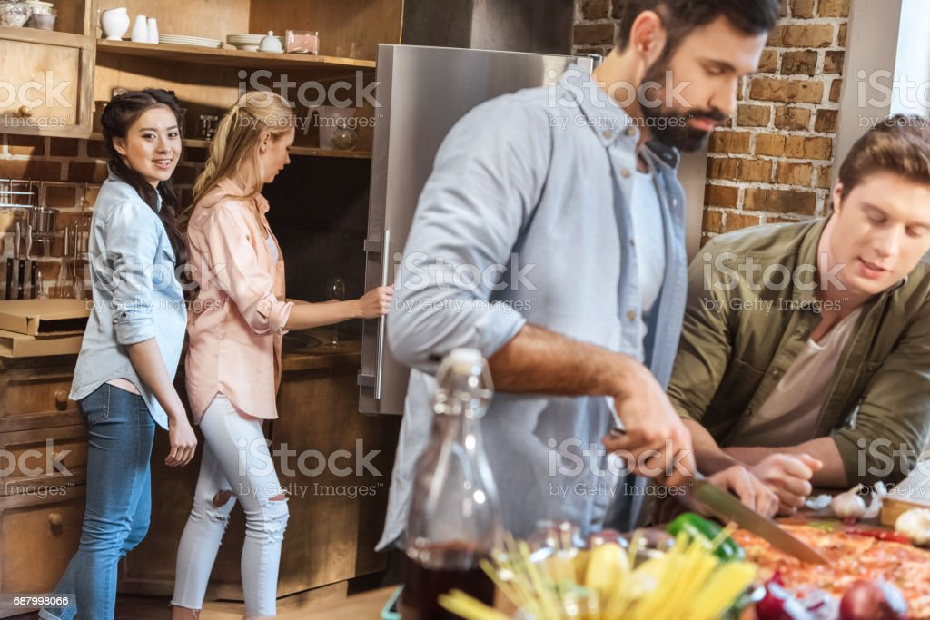 Guys cutting pizza stock photo