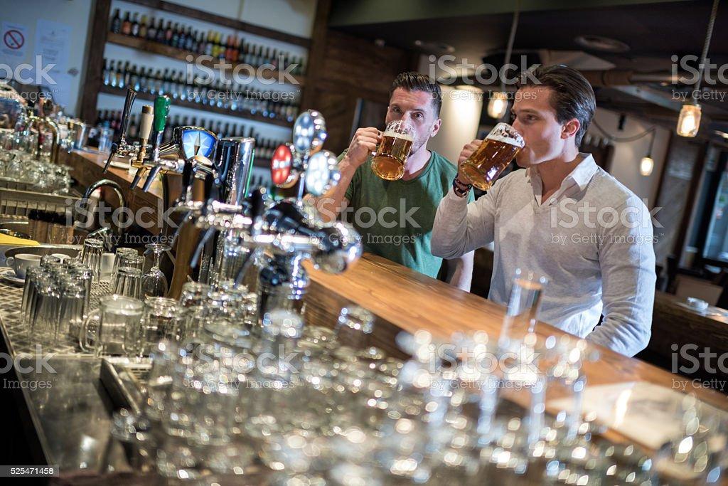 Guys in the pub stock photo