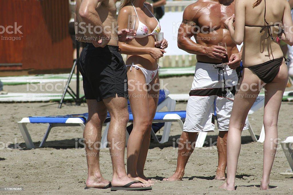 guys on the beach stock photo