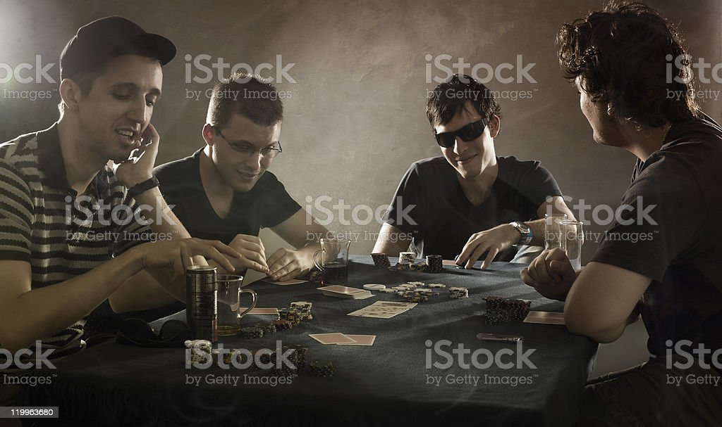 4 guys playing poker stock photo