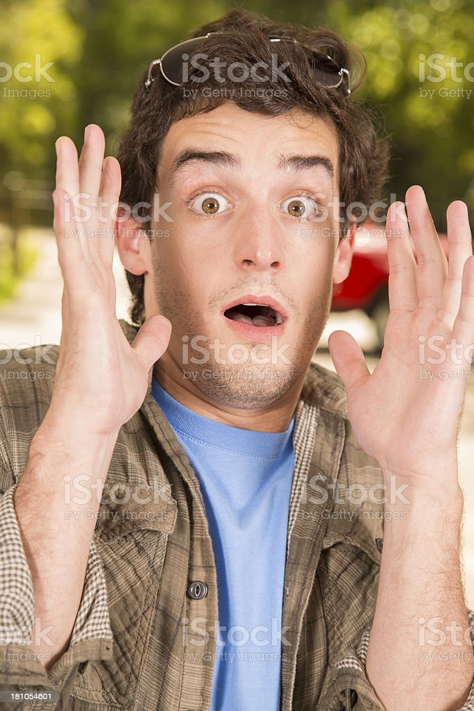 Guys:  Surprised young adult male. Hands in air mouth open royalty-free stock photo