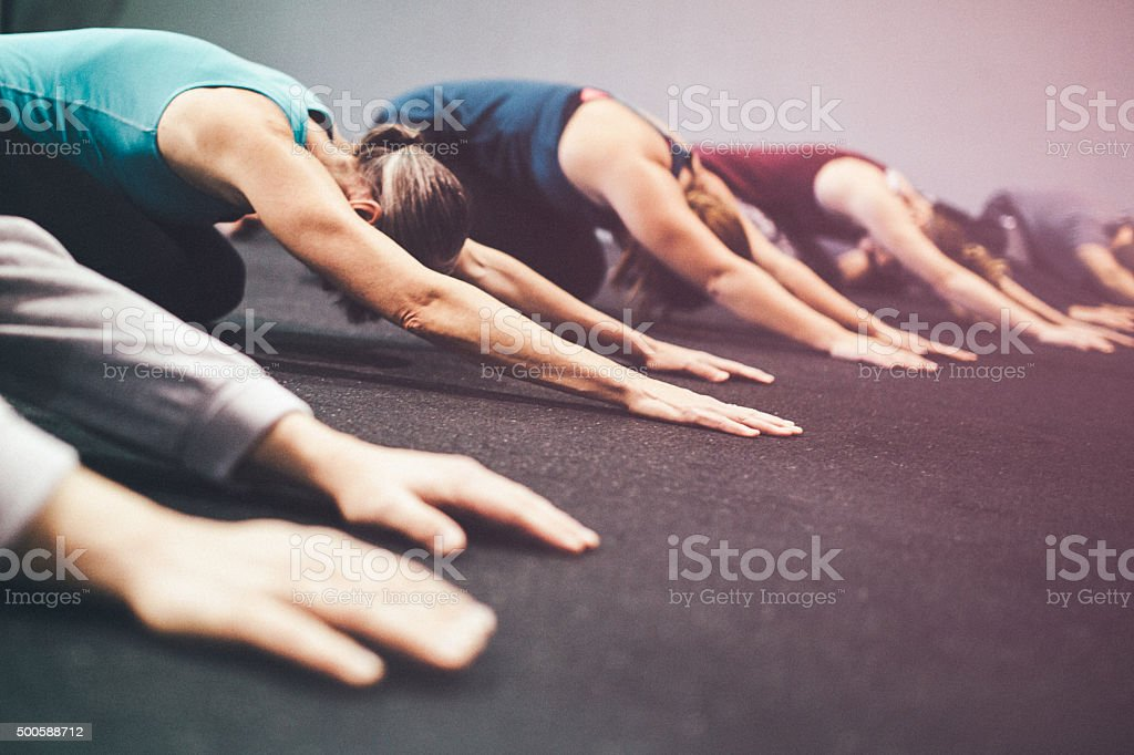 Gym Class Doing Childs Pose stock photo