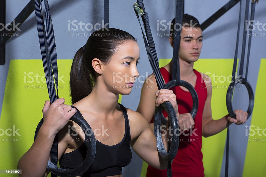 gym dip ring man and woman relaxed after workout royalty-free stock photo