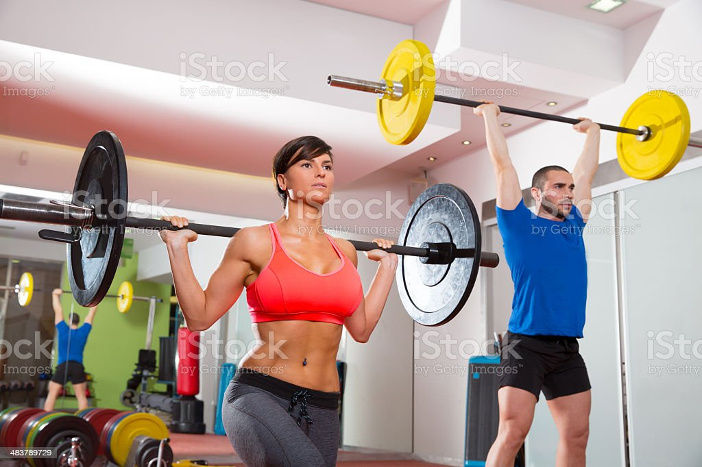 gym fitness gym weight lifting bar group royalty-free stock photo