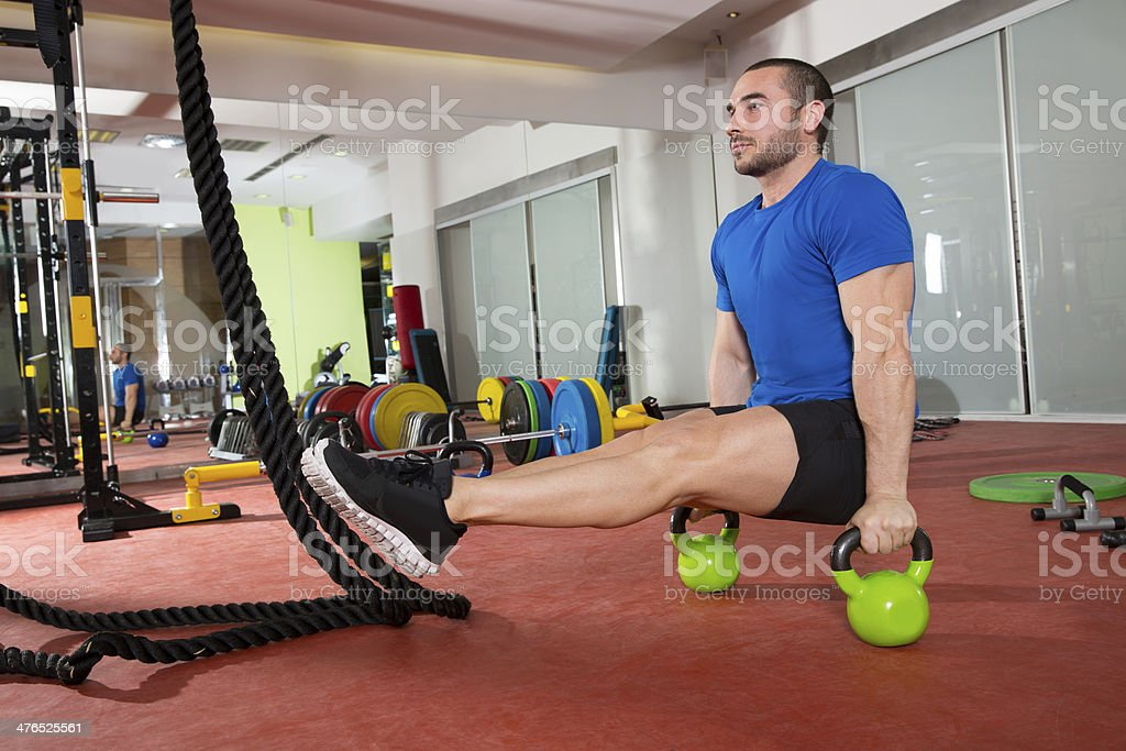 gym fitness man L-sits Kettlebells L sits exercise royalty-free stock photo
