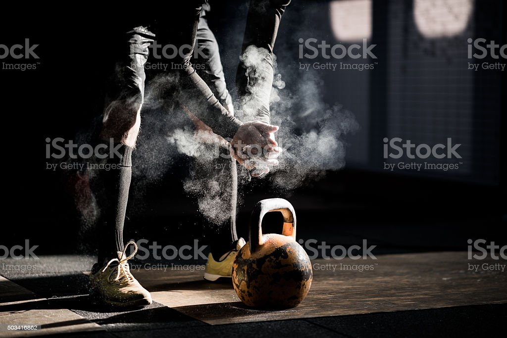 Gym fitness workout: Man ready to exercise with kettle bell royalty-free stock photo