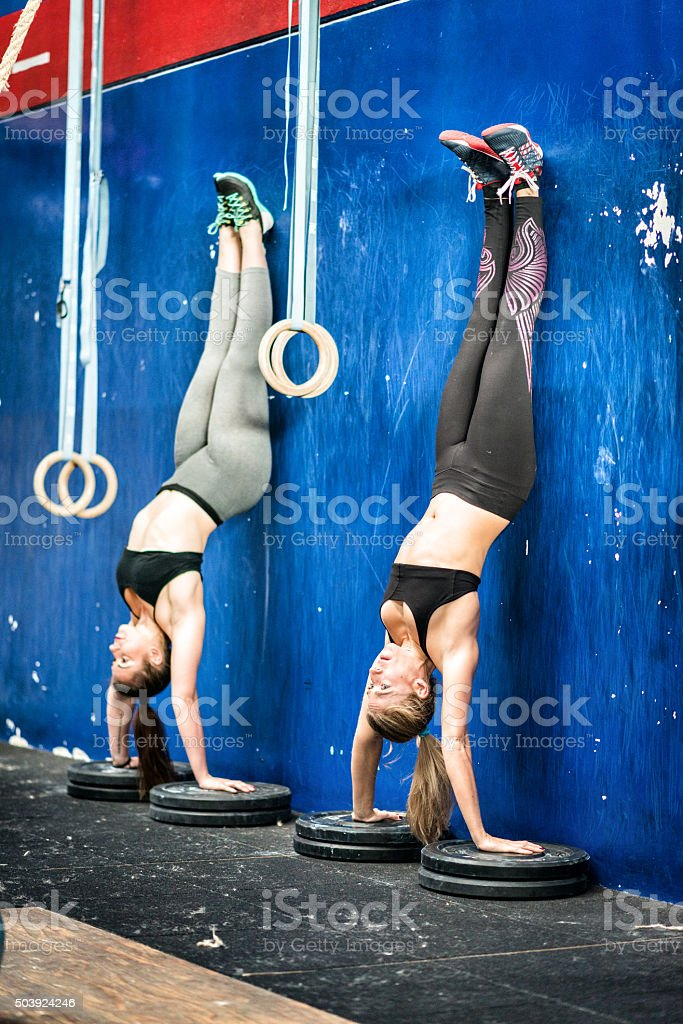 Gym fitness workout: Women handstand stock photo