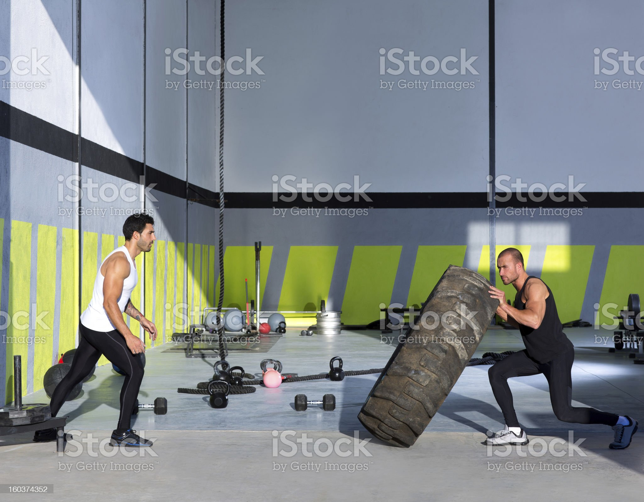 Crossfit flip tires men flipping each other royalty-free stock photo