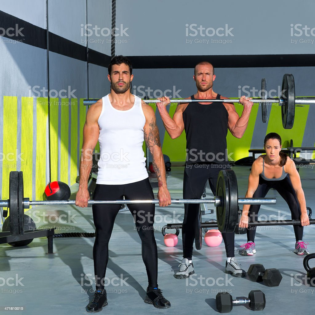 gym group with weight lifting bar gym workout royalty-free stock photo